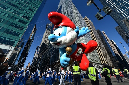 The Papa Smurf balloon floats over the streets during the 87th Annual Macy's Thanksgiving Day Parade.  Photo: Anadolu Agency/Getty Images. Courtesy of wired.com