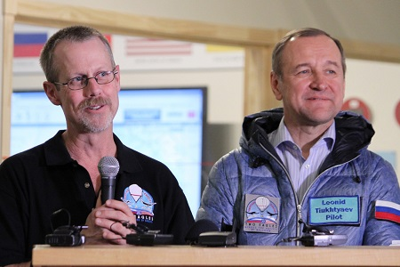 In this Feb. 2, 2015 file photo, pilots Troy Bradley, left, and Leonid Tiukhtyaev discuss their record-breaking gas balloon flight across the Pacific Ocean during a final debriefing at mission control in Albuquerque, N.M. A documentary on their flight will premiere Feb. 6, 2016 at the KiMo Theatre in Albuquerque. Photo: AP/Susan Montoya Bryan