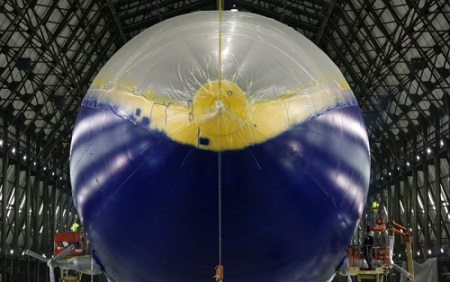 Employees with Thomarios in Copley, apply another coat of blimp blue V2 on Goodyear's new airship.  Photo: Ed Suba Jr. - Akron Beacon Journal.