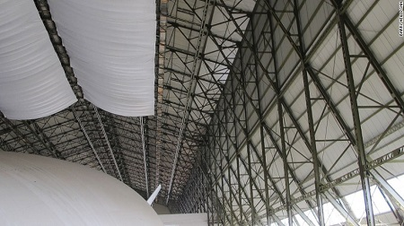 Restoration project – The old hangar is a protected building under English planning laws and was carefully restored to accommodate the Airlander. Those overhead drapes are to catch droppings from birds entering the building. Source: CNN