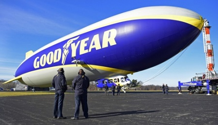 Jerry Hissen (right), the chief pilot, and Adam Basaran, the assistant chief pilot, watch as the engines on the new Goodyear new technology airship are tested. Photo: David Dermer - Akron Beacon Journal.
