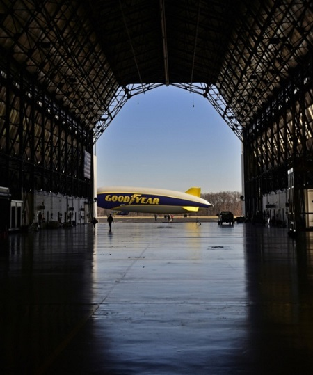 The second Goodyear new technology airship is framed in the open hangar door before flight tests. Photo: David Dermer - Akron Beacon Journal.