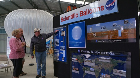 Henry Cathey, Super Pressure Balloon project engineer, talks about the balloon flight train to local residents visiting NASA's scientific balloon exhibit at the Wanaka Airport March 24. Image courtesy of NASA.