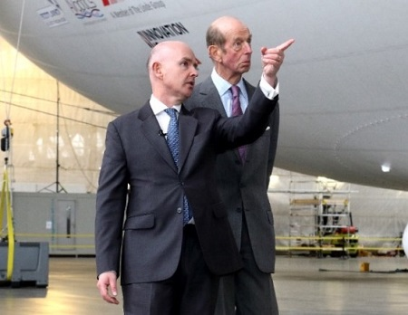 Philip Gwyn points out some of the features of the Airlander 10 to Prince Edward, Duke of Kent. Source: bobfm.co.uk.