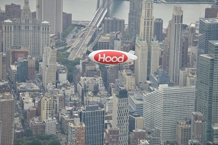 The Hood Blimp delivers a splash of color to its home city. Photo: Van Wagner Airship Group