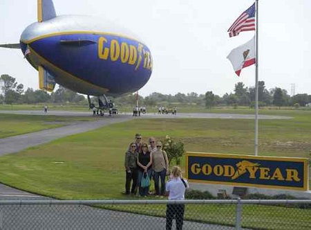 Passengers pose for a photo in front of the Goodyear blimp Spirit of Innovation before a flight from its base in Carson, CA, on Tuesday, September 22, 2015.  File Photo. Scott Varley / Daily Breeze