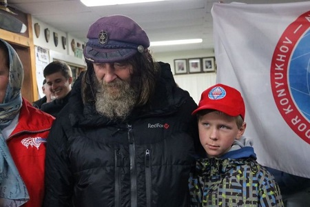 Fedor Konyukhov celebrates with his son, Oscar, after spending 11 days on a hot air balloon. Photo: Laura Gartry - ABC News