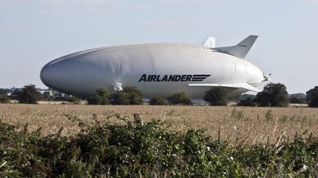 The Airlander 10 slowly emerged from its hangar in the early hours of Saturday. Image: BBC/South Beds News Agency.