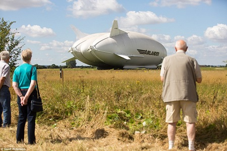 Members of the public looking at the world's largest aircraft ,the Airlander 10,out in the open air for the first time today. Image: Daily Mail/Geoff Robinson.