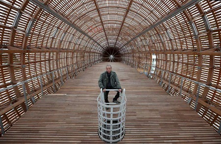 Leos Valka, a co-creator, poses for a photo inside a giant object resembling a zeppelin airship at an arts center in Prague, Czech Republic. Photo: Petr David Josek, AP
