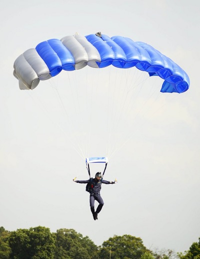 Air Force Wings Of Blue parachute team member Jordan Glover comes in for a landing after jumping from the Goodyear blimp Wingfoot Two. Photo: Paul Efird/News Sentinel.