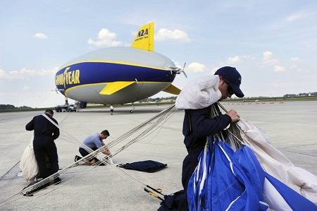 Cadet Jordan Glover, right, and other Air Force Wings Of Blue parachute team members ready their chutes for a practice jump from the Goodyear blimp Wingfoot Two.  Photo: Paul Efird/News Sentinel.