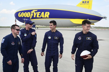 U.S. Air Force Wings Of Blue parachute team members MSgt. Patrick Sullivan, Cadet Gabriel Dawson, Cadet Jordan Glover, and Lt. Col. Sean Baerman are pictured with the Goodyear blimp Wingfoot Two.  Photo: Paul Efird/News Sentinel.