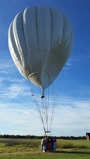 Residents help secure the balloon, Foxtrot Charlie, piloted by Peter Cuneo and Barbara Fricke, after landing in a field west of Monroe City, Mo., on Sunday, to win the America's Challenge Gas Balloon Race.  Photo: abqjournal.com, courtesy of Peter Cuneo and Barbara Fricke